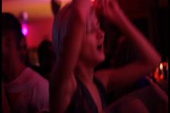 Girl dancing going wild crazy in nightclub enjoying music, click for HD Stock Footage