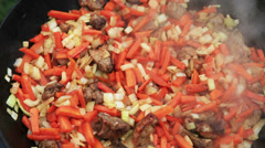 Pilaf (Plov) preparation - Afghan, Uzbek, Tajik national cuisine main dish Stock Footage