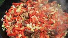Pilaf (Plov) preparation - Afghan, Uzbek, Tajik national cuisine main dish Stock Footage