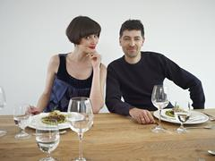 Stock Photo of Germany, Cologne, Man and woman having dinner, portrait