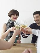 Stock Photo of Germany, Cologne, Men and women clinking glasses