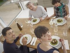 Germany, Cologne, Men and women having dinner Stock Photos