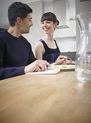 Stock Photo of Germany, Cologne, Man and woman having dinner, smiling
