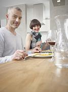 Germany, Cologne, Man and woman having dinner, smiling Stock Photos