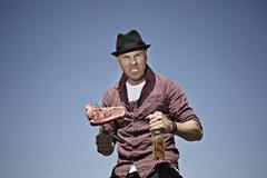 Germany, Cologne, Mature man with meat and beer Stock Photos