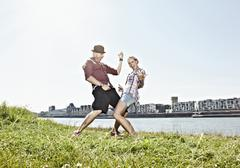 Germany, Cologne, Couple playing air guitar Stock Photos
