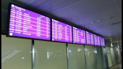 Information screens at airport. Flight arrivals and departures, click for HD Stock Footage
