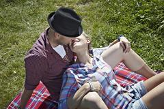 Germany, Cologne, Couple laying in grass Stock Photos