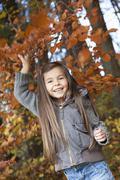Stock Photo of Germany, Huglfing, Girl smiling, portrait