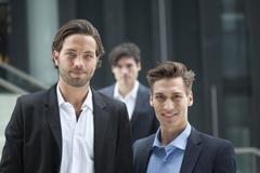 Germany, North-Rhine-Westphalica, Duesseldorf, Young businessmen standing, Stock Photos