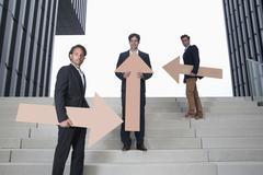 Germany, North Rhine Westphalia, Duesseldorf, Young businessmen standing on - stock photo