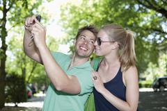Germany, North Rhine Westphalia, Duesseldorf, Couple taking photo of themselves, - stock photo