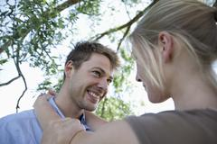Germany, North Rhine Westphalia, Duesseldorf, Couple in romance, smiling - stock photo