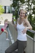Stock Photo of Germany, North-Rhine-Westphalica, Duesseldorf, Mid adult woman with headphones,