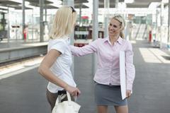 Germany, North-Rhine-Westphalica, Duesseldorf, Two businesswomen at platform Stock Photos