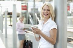 Germany, North-Rhine-Westphalica, Duesseldorf, Businesswoman with smart phone, Stock Photos