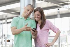 Stock Photo of Germany,  North-Rhine-Westphalia, Duesseldorf, Young couple watching mobile