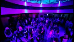 Dancing people flying camera in night club during party, click for HD - stock footage