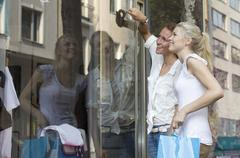Germany, North Rhine Westphalia, Cologne, Young women at window shopping, Stock Photos