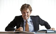 angry bsuinessman grinding teeth - stock photo
