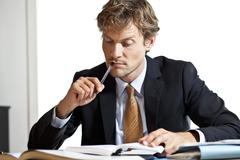 businessman trying to figure out the work - stock photo