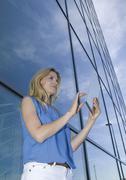 Europe, Germany, North Rhine Westphalia, Duesseldorf, Businesswoman using - stock photo