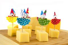 Cheese cubes for child party Stock Photos