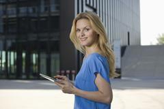 Europe, Germany, North Rhine Westphalia, Duesseldorf, Businesswoman using Stock Photos