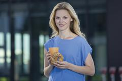 Stock Photo of Europe, Germany, North Rhine Westphalia, Duesseldorf, Mid adult woman with food