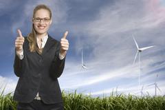 Germany, North Rhine Westphalia, Duesseldorf, Businesswoman showing thumbs up Stock Photos