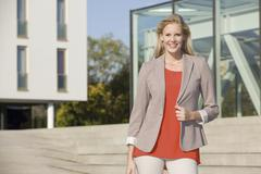 Stock Photo of Europe, Germany, North Rhine Westphalia, Duesseldorf, Businesswoman smiling,