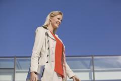 Europe, Germany, North Rhine Westphalia, Duesseldorf, Businesswoman with Stock Photos