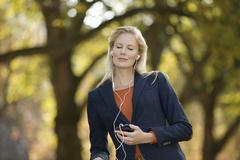 Europe, Germany, North Rhine Westphalia, Duesseldorf, Young woman listening - stock photo