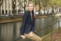 Stock Photo of Europe, Germany, North Rhine Westphalia, Duesseldorf, Young woman smiling,