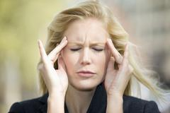 Europe, Germany, North Rhine Westphalia, Duesseldorf, Young woman with headache Stock Photos