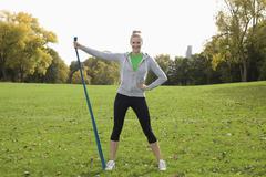 Europe, Germany, North Rhine Westphalia, Duesseldorf, Young woman exercising - stock photo