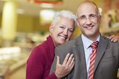 Stock Photo of Germany, Cologne, Mature couple in supermarket, smiling, portrait