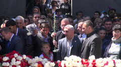 Laying flowers at genocide monument, Yerevan - stock footage