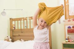 Girl undressing, smiling, portrait Stock Photos