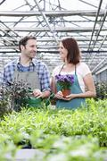 Germany, Bavaria, Munich, Mature man and woman in greenhouse with rocket and Stock Photos
