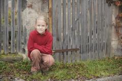 Germany, Bavaria, Girl in front of fence, portrait Stock Photos