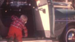 Old Vintage Film 1940's Blonde Hair Little Boy Climbs Car Automobile Driveway Stock Footage