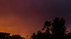 HD 24p ti Dramatic sunset colored sky day to night powerful lightning time lapse Stock Footage