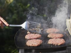 Germany, Munich, Mature man frying ground beef - stock photo