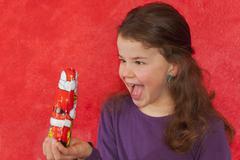 Girl staring at chocolate santa claus - stock photo