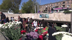 Genocide Remembrance Day, people sell flowers - stock footage