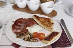 United Kingdom, Northern Ireland, Irish Breakfast in plate, close up - stock photo