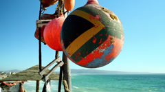 South African flag painted on a buoy Stock Footage