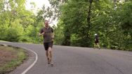 Stock Video Footage of Male Runner. Steadicam shot