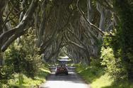 Stock Photo of United Kingdom, Northern Ireland, County Antrim, View of car on road